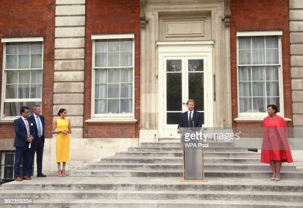 Prince Harry Duke of Sussex makes a speech watched by Meghan Duchess of Sussex and Commonwealth secretary general Baroness Scotland during the Your...