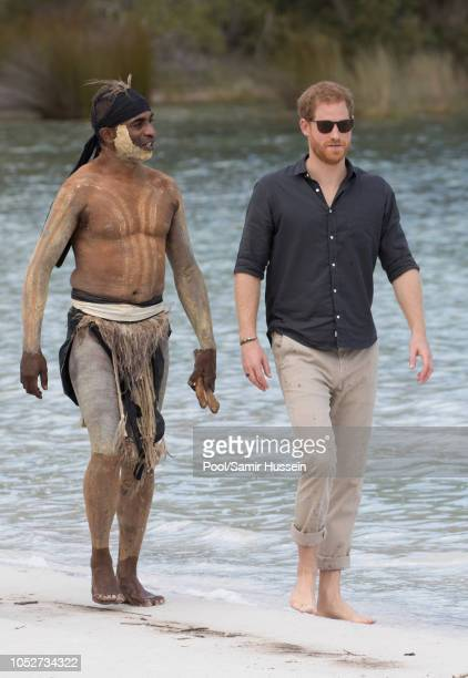 Prince Harry Duke of Sussex meets a local elder as he visits Lake McKenzie on October 22 2018 in Fraser Island Australia The Duke and Duchess of...