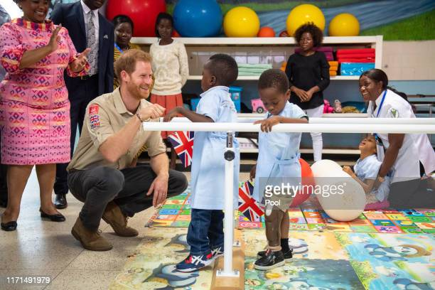 Prince Harry Duke of Sussex meets Barnaby Jose Mar as he visits the Princess Diana Orthopaedic Centre in Huambo on day five of the royal tour of...