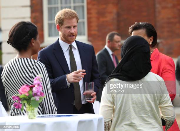 Prince Harry Duke of Sussex meets guests during the Your Commonwealth Youth Challenge reception at Marlborough House on July 05 2018 in London England