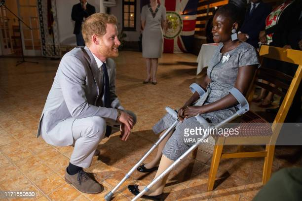 Prince Harry, Duke of Sussex meets landmine victim Sandra Tigica, who met Princess Diana, Princess of Wales on her visit to Angola 1997, during a...