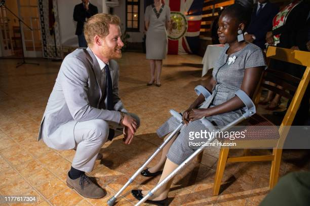 Prince Harry Duke of Sussex meets landmine victim Sandra Tigica who Princess Diana met on her visit to Angola 1997 at a reception at the British...