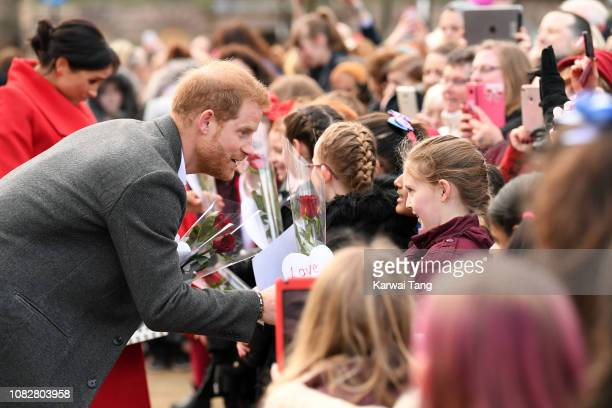 Prince Harry, Duke of Sussex meets members of the public during a visit of Birkenhead at Hamilton Square on January 14, 2019 in Birkenhead, UK.