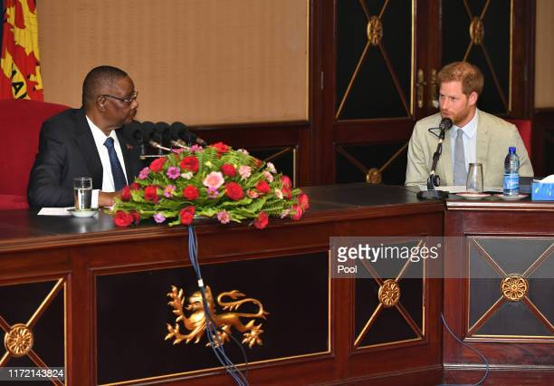 Prince Harry Duke of Sussex meets with Professor Arthur Peter Mutharika President of the Republic of Malawi at the State House on day seven of the...