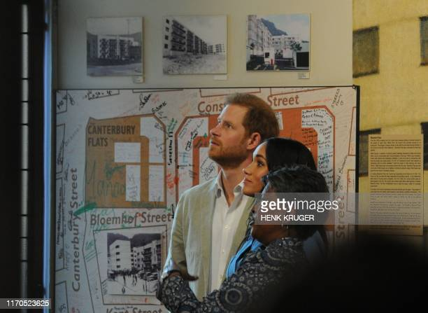 Prince Harry Duke of Sussex Meghan Duchess of Sussex and Bonita Bennett head of District Six museum visit the museum in Cape Town on the first...