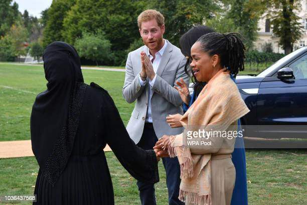 Prince Harry Duke of Sussex Meghan Duchess of Sussex and her mother Doria Ragland are greeted by Zahira Ghaswala Hubb community kitchen coordinator...