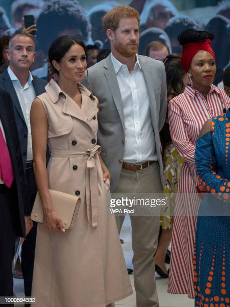 Prince Harry Duke of Sussex Meghan Duchess of Sussex and Nelson Mandela's granddaughter Zamaswazi DlaminiMandela look on during a visit to the Nelson...