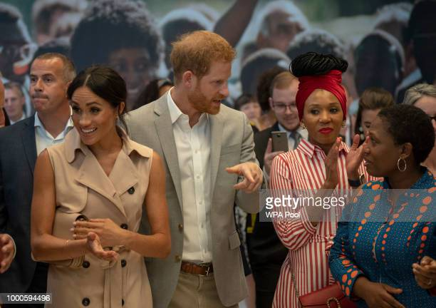 Prince Harry Duke of Sussex Meghan Duchess of Sussex and Nelson Mandela's granddaughter Zamaswazi DlaminiMandela applaud during a visit to the Nelson...