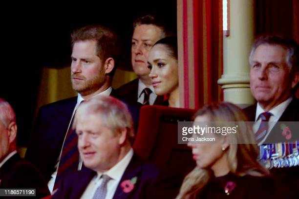 Prince Harry, Duke of Sussex, Meghan, Duchess of Sussex and Prime Minister, Boris Johnson attend the annual Royal British Legion Festival of...
