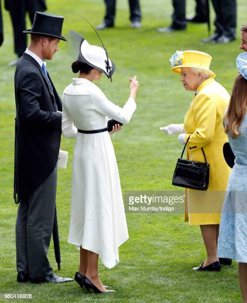 Prince Harry Duke of Sussex Meghan Duchess of Sussex and Queen Elizabeth II attend day 1 of Royal Ascot at Ascot Racecourse on June 19 2018 in Ascot...