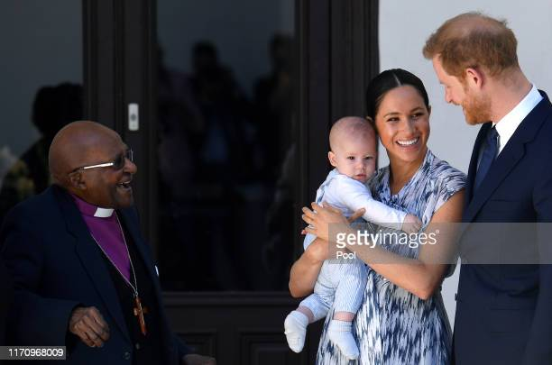Prince Harry Duke of Sussex Meghan Duchess of Sussex and their baby son Archie MountbattenWindsor meet Archbishop Desmond Tutu at the Desmond Leah...