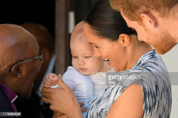 Prince Harry, Duke of Sussex, Meghan, Duchess of Sussex and their baby son Archie Mountbatten-Windsor meet Archbishop Desmond Tutu at the Desmond &...