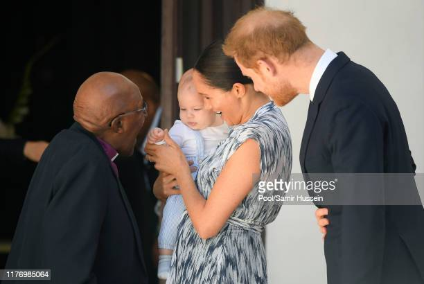 Prince Harry Duke of Sussex Meghan Duchess of Sussex and their baby son Archie MountbattenWindsor meet Archbishop Desmond Tutu and his daughter...