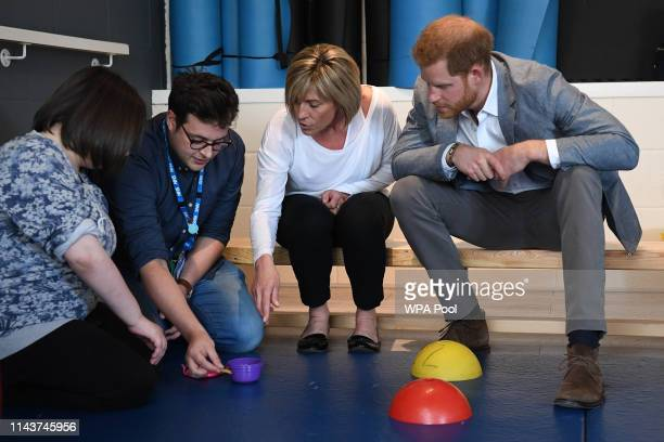 Prince Harry Duke of Sussex observes a therapy session as he visits the OXSRAD Disability Sports and Leisure Centre on May 14 2019 in Oxford England
