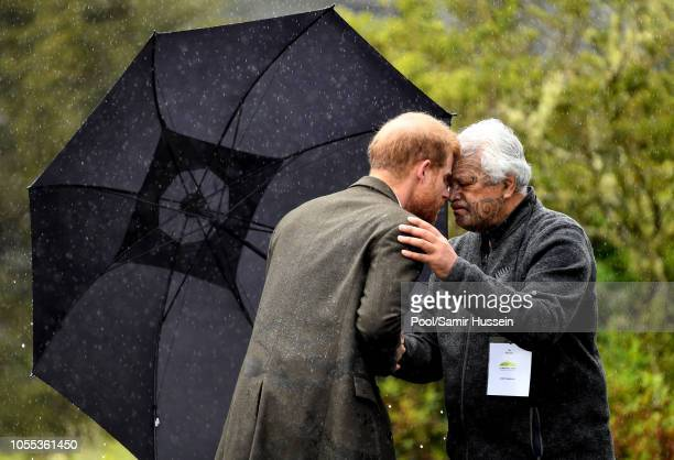 Prince Harry Duke of Sussex performs a hongi as he visits the North Shore to dedicate a 20hectare area of native bush to The Queen's Commonwealth...