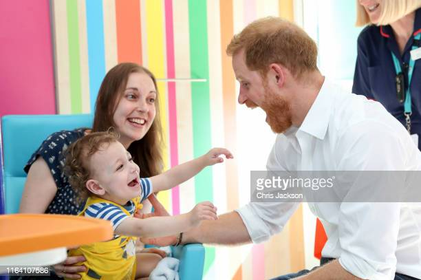 Prince Harry, Duke of Sussex plays with one year old Noah Nicholson, during a visit to Sheffield Children's Hospital on July 25, 2019 in Sheffield,...