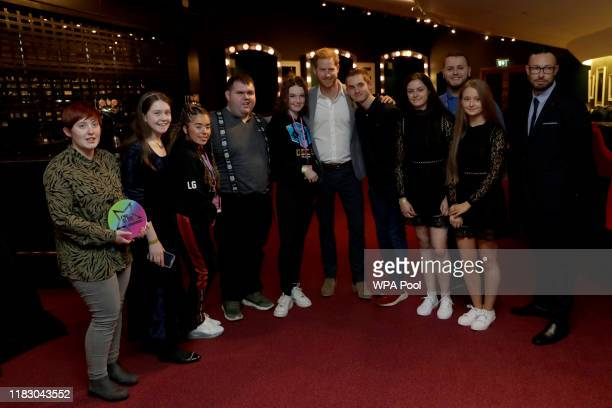 Prince Harry Duke of Sussex poses for a group shot as he meets nominees winners and performers including Connor Tyson fourth left from Carlisle...
