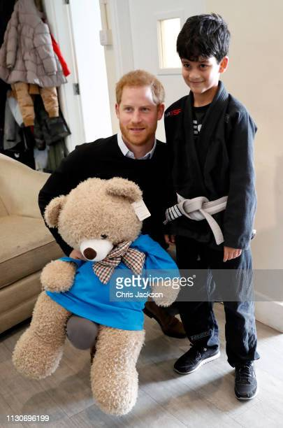 Prince Harry Duke of Sussex poses for a photo with a participant during his visit to a 'Fit and Fed' halfterm initiative in Streatham on February 19...