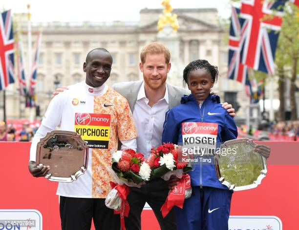 Prince Harry Duke of Sussex poses with Eliud Kipchoge winner of the men's London marathon and Brigid Kosgei winner of the women's London marathon...