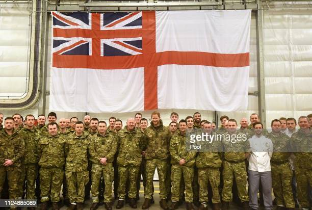 Prince Harry Duke of Sussex poses with service personnel during a visit to Exercise Clockwork in Bardufoss Norway for a celebration of the 50th...