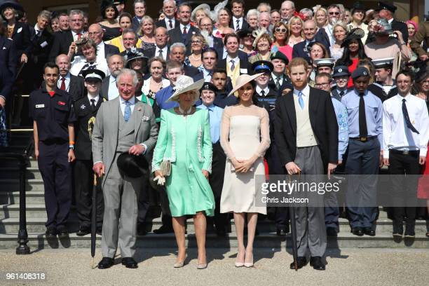 Prince Harry Duke of Sussex Prince Charles Prince of Wales Camilla Duchess of Cornwall Meghan Duchess of Sussex and guests pose for a photograph as...