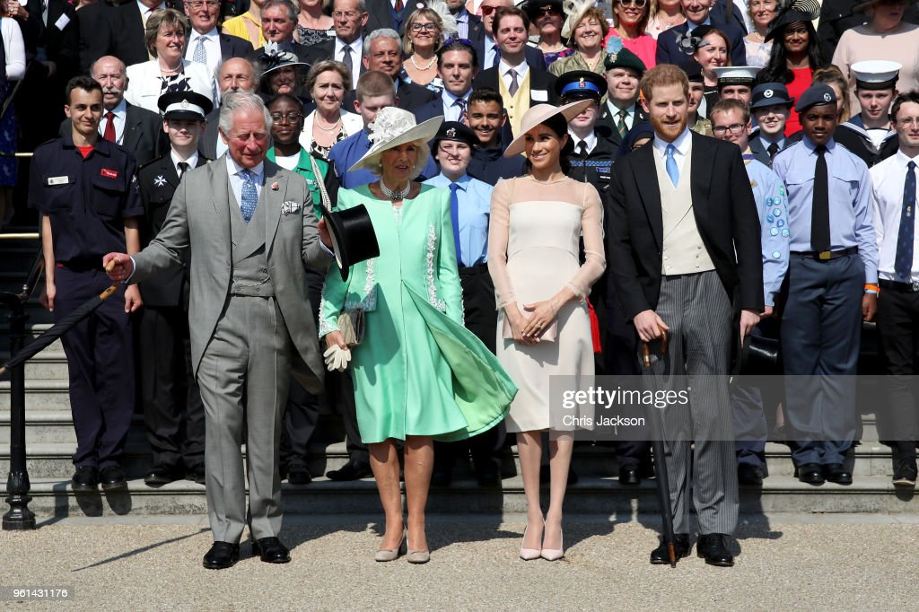 Prince Harry, Duke of Sussex, Prince Charles, Prince of Wales, Camilla, Duchess of Cornwall, Meghan, Duchess of Sussex and guests pose for a photograph as they attend The Prince of Wales' 70th Birthday Patronage Celebration held at Buckingham Palace on May 22, 2018 in London, England.