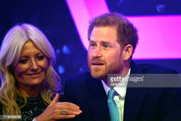 Prince Harry Duke of Sussex reacts next to television presenter Gaby Roslin as he delivers a speech during the WellChild awards at Royal Lancaster...