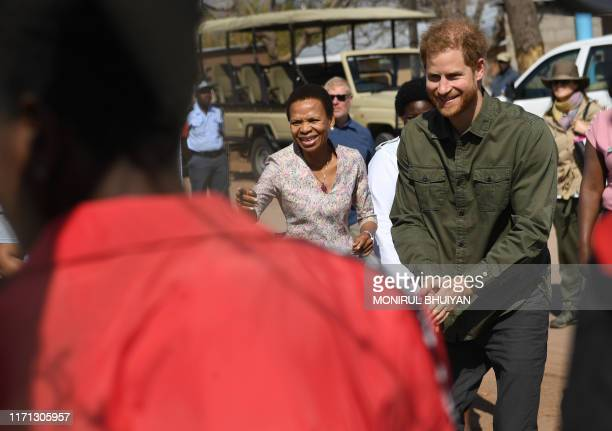 Prince Harry Duke of Sussex reacts on his arrival at The Princes' foundation for children in Africa Sentebale at the Chobe district in the Northern...