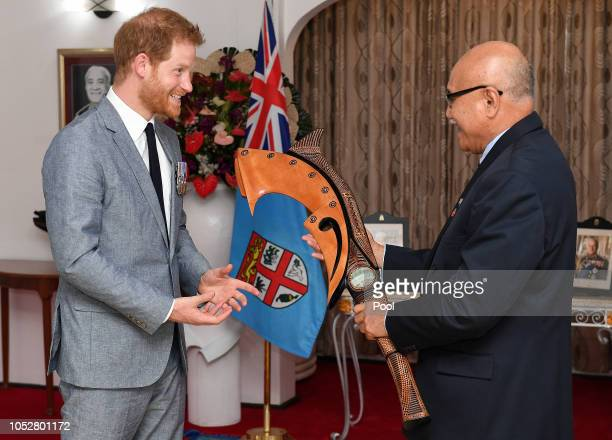 Prince Harry Duke of Sussex receives a gift from the President of Fiji Jioji Konrote on the first day of their tour to Fiji on October 23 2018 in...