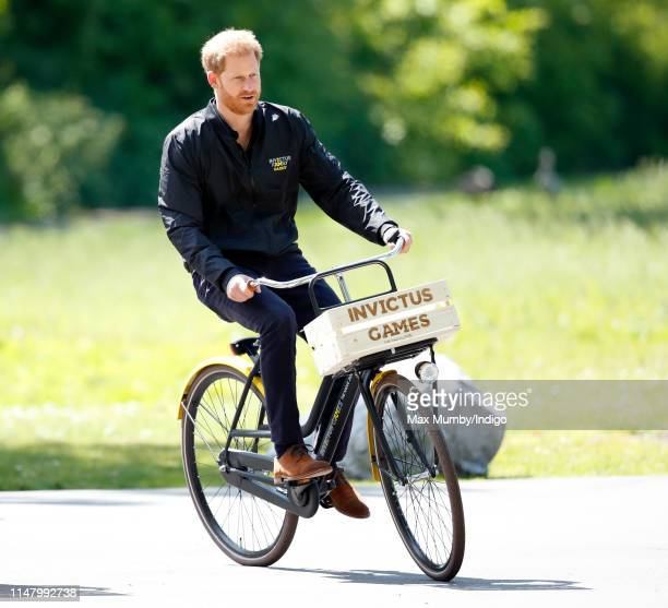 Prince Harry Duke of Sussex rides a bicycle around Sportcampus Zuiderpark as part of a programme of events to mark the official launch of the...
