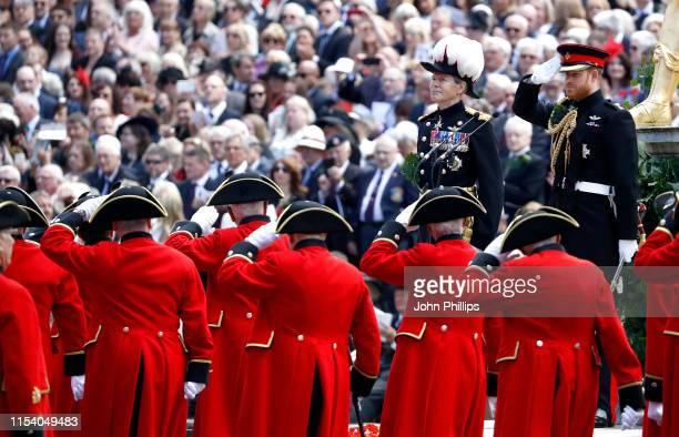 Prince Harry, Duke of Sussex salutes the veterans and Chelsea Pensioners as he attends the annual Founder's Day parade at Royal Hospital Chelsea on...