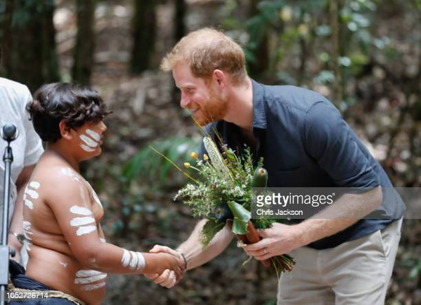 Prince Harry Duke of Sussex shaking the hand of a young boy form the K'gari tribe under the Queens Commonwealth Canopy on October 22 2018 in Fraser...