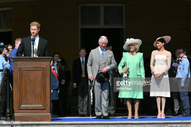 Prince Harry Duke of Sussex speaks as Prince Charles Prince of Wales Camilla Duchess of Cornwall and Meghan Duchess of Sussex listen during The...