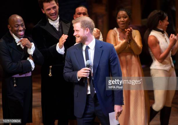 "Prince Harry, Duke of Sussex speaks onstage at ""Hamilton"" after the gala performance in support of Sentebale at Victoria Palace Theatre on August 29,..."