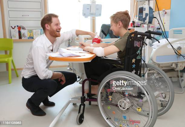 Prince Harry, Duke of Sussex speaks with 11 year old Heath Keighley during a visit to Sheffield Children's Hospital on July 25, 2019 in Sheffield,...