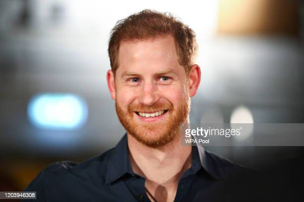 Prince Harry, Duke of Sussex speaks with members of the Invictus Games Choir at Abbey Road Studios, where a single has been recorded for the Invictus...