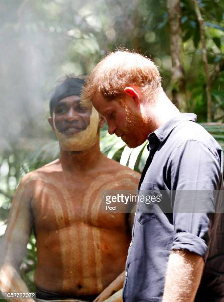 Prince Harry Duke of Sussex stands next to a member of the Butchulla People during a dedication dedication ceremony of the forests of K'gari the...