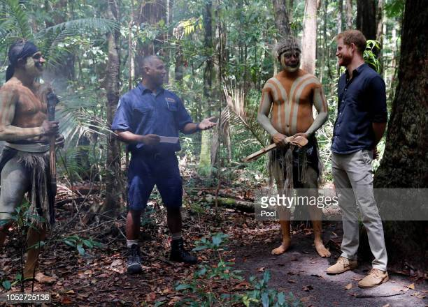Prince Harry Duke of Sussex stands next to Butchulla People during a dedication dedication ceremony of the forests of K'gari the Queen's Commonwealth...