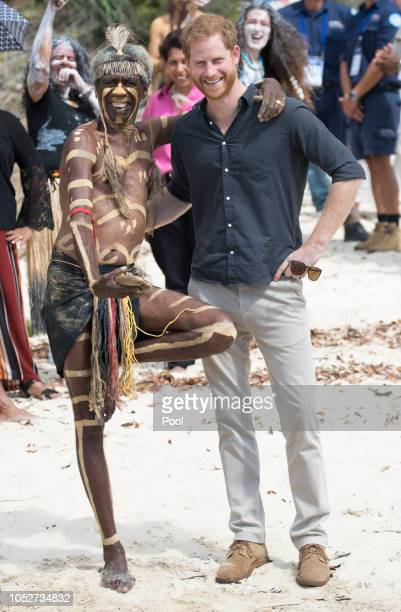 Prince Harry Duke of Sussex stands with aboriginal man Joe Gala at McKenzie's Jetty where he took part in an aboriginal cleansing ceremony on Fraser...