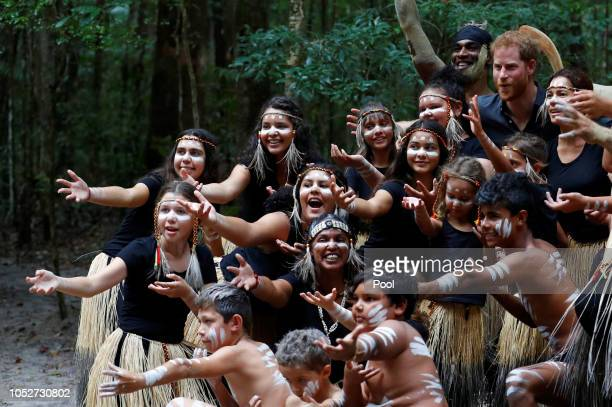 Prince Harry Duke of Sussex takes a photo with Butchulla People during a dedication ceremony of the forests of K'gari the Queen's Commonwealth Canopy...