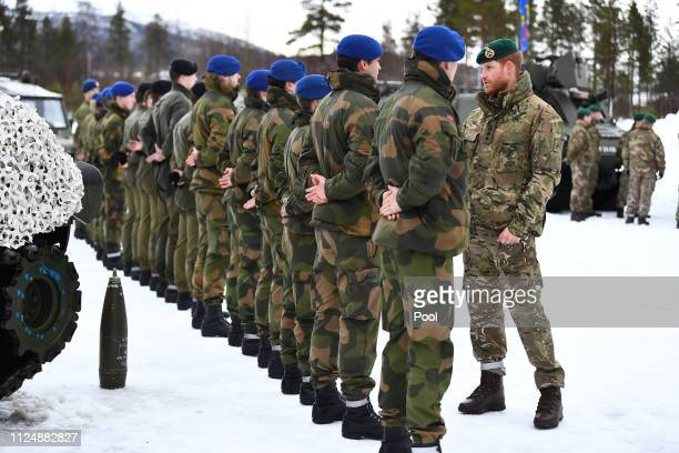 Prince Harry Duke of Sussex talks to Norwegian service personnel during a visit to Exercise Clockwork in Bardufoss Norway for a celebration of the...