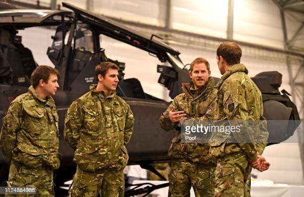Prince Harry Duke of Sussex talks to service personnel during a visit to Exercise Clockwork in Bardufoss Norway for a celebration of the 50th...