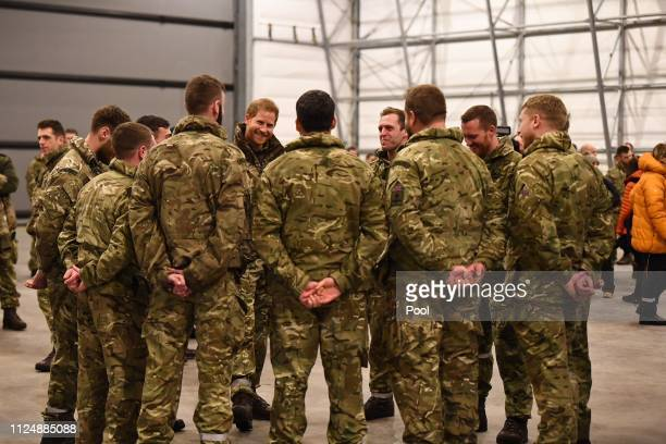 Prince Harry Duke of Sussex talks with service personnel during a visit to Exercise Clockwork in Bardufoss Norway for a celebration of the 50th...