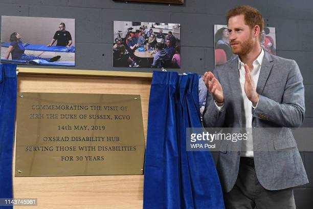 Prince Harry Duke of Sussex unveils a plaque commemorating his visit to the OXSRAD Disability Sports and Leisure Centre on May 14 2019 in Oxford...