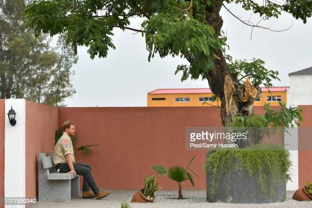 Prince Harry, Duke of Sussex walks on Princess Diana Street on day five of the royal tour of Africa on September 27, 2019 in Dirico, Angola. The Duke...