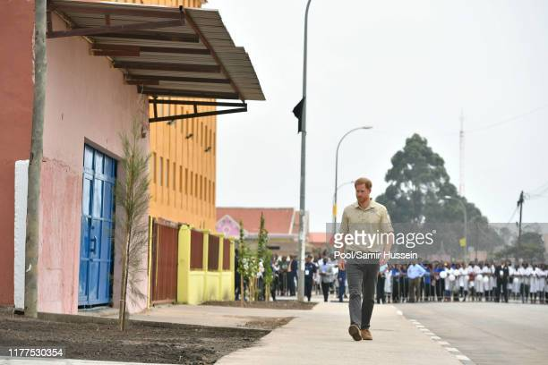 Prince Harry Duke of Sussex walks on Princess Diana Street on day five of the royal tour of Africa on September 27 2019 in Dirico Angola The Duke is...