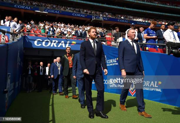 Prince Harry Duke of Sussex walks on to the pitch before The Rugby League Challenge Cup Final St Helens v Warrington Wolves at Wembley Stadium on...