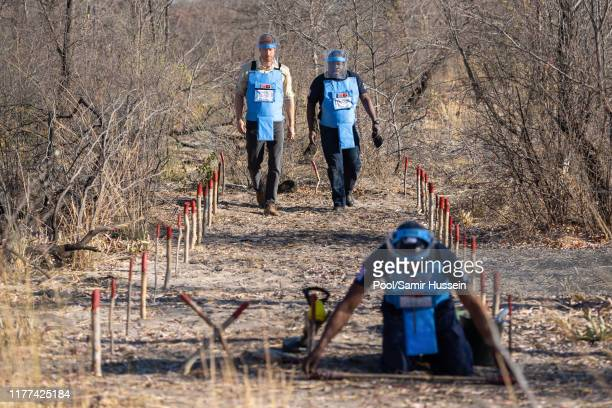 Prince Harry, Duke of Sussex walks through a minefield during a visit to see the work of landmine clearance charity the Halo Trust, on day five of...