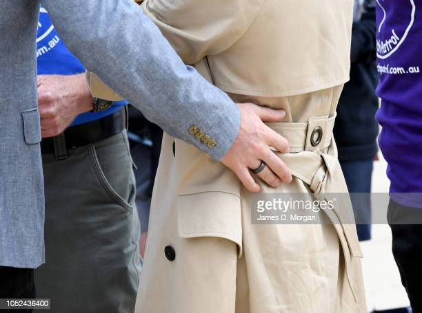 Prince Harry Duke of Sussex wearing a new black metallic ring as he puts his hand on his wife Megan Duchess of Sussex on October 18 2018 in Melbourne...
