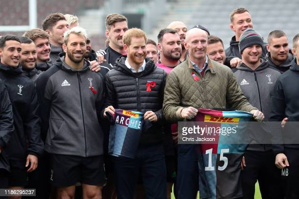 Prince Harry, Duke of Sussex with former Wales rugby captain, Gareth Thomas and Chris Robshaw of Harlequins as he is presented with a Harlequins kit...
